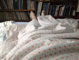 Legs sticking out of bed