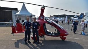 French railway (SNCF) personnel stand by an Auto Gyro Gyroplane inspection unit aircraft used by the SNCF to monitor railways, at the International Paris Air Show in Le Bourget outside Paris on June 21, 2017