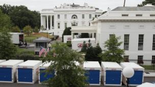 West Executive Drive outside the West Wing shown filled with large containers during the refurbishments.