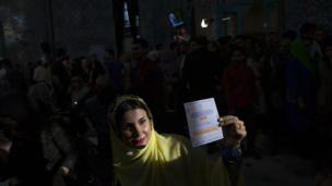 Woman holds her voting slip in Tehran, Iran - 19 May 2017