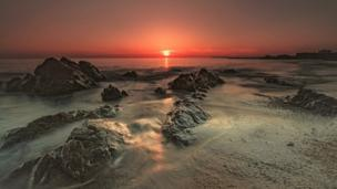 Sunset at Ty'n Tywyn beach on Anglesey