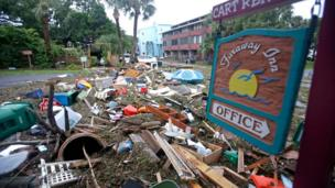 A street is blocked from debris washed up from the tidal surge of Hurricane Hermine Friday, 2 September 2016, in Cedar Key, Fla.