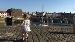 Miriam running around Dunbar harbour