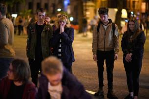 Members of the public attend a candlelit vigil in Albert Square, Manchester, 23 May