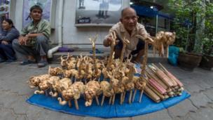 Man selling craft in Bangkok