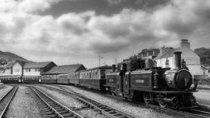 The Double Fairlie locomotive Merddin Emrys awaits to depart Harbour Station in Porthmadog