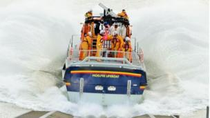 Moelfre Lifeboat Kiwi making a splash on a launch during a training exercise by Sharon Jones-Williams.
