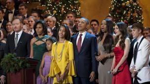"""Obamas at recording of """"Christmas in Washington"""" performance with Justin Bieber (r), Victoria Justice (2nd r), Jennifer Hudson (3rd r) and Conan O'Brien."""