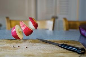 An apple caught mid-air