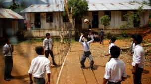 Mr Kami plays volleyball with friends during a break