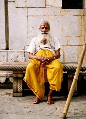 A man sitting outside a temple near the Amber Fort, Jaipur, in Rajasthan.