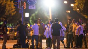 Anxious relatives gather at the scene of the shooting. 23 July 2016