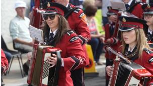 Bands women play accordions in the parade in Richhill, Armagh, 12 July 2017