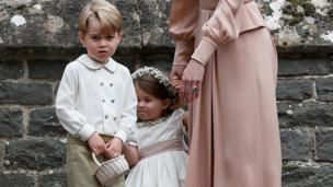 prince George and princess Charlotte stand with their mother, the Duchess of Cambridge.