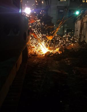 Sparks fly as a man carries out maintenance work