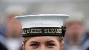 Crew member wearing HMS Queen Elizabeth hat