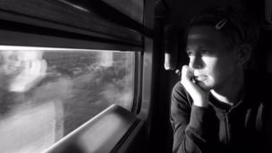 Woman looking out of train window