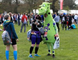 Competitors in fancy dress take a selfie before the London Marathon