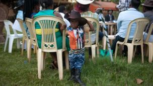 Alvin Kivumbi, aged three, wears a cowboy outfit in Kampala