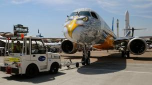 A truck pulls an Embraer E195-E2 towards the runway at the tarmac at the International Paris Air Show in Le Bourget outside Paris on June 20, 2017
