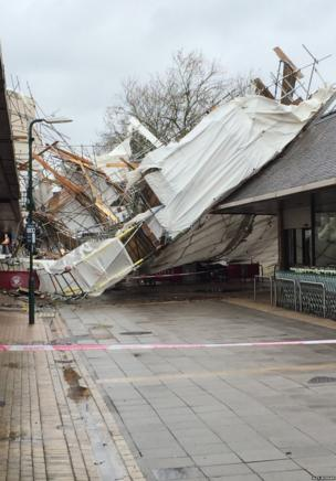 "The main shopping street in Woodley, Reading. Alex Morgan says: ""The scaffolding from the building on the left has been ripped off and now covers the high street"". Credit: Alex Morgan"