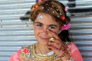 Iraqi girl celebrates Eid al-Fitr in Mosul, 25 June