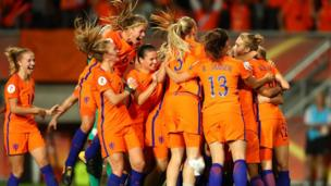 The Netherlands celebrates with team mates following the UEFA Women's Euro 2017 Semi Final match between Netherlands and England at De Grolsch Veste Stadium