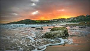 Orange sunset over Langland Bay, Swansea, taken, by Mark Campion