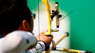 Woojin Kim of South Korea takes aim during the Men's Individual Ranking Round