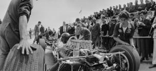 Racing driver Jim Clark (1936 - 1968) during a pit stop before a practice lap at Silverstone, 14th July 1967.