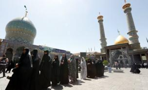 Veiled Iranian women waits in a line to cast their ballots in the Iranian presidential elections at a polling station set up at the Abdol Azim shrine in the city of Shahre-Ray, south of the capital of Tehran, Iran, 19 May 2017