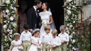 James Matthews and Pippa Middleton outside the church after they are married