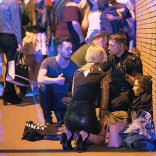 Police and other emergency services are seen helping the injured near the Manchester Arena after an explosion.