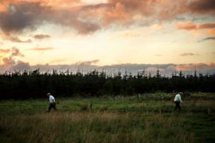 Two brothers who own and run the family farm mending fences in Rusheens, County Roscommon