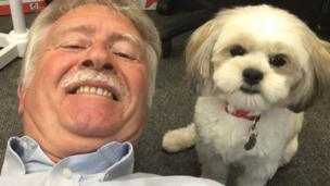 Bernard lying on the floor to take a 'selfie' with Pippa