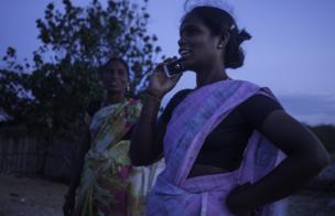Amudha speaking on a mobile phone.
