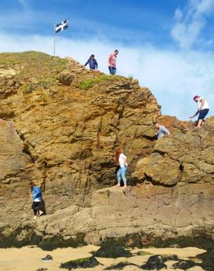 Family on rocks