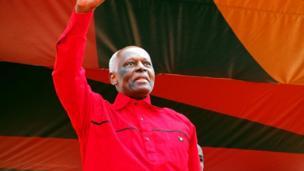 President Jose Eduardo dos Santos of Angola dey wave
