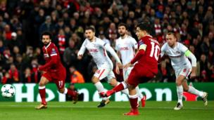 Philippe Coutinho of Liverpool scores his side's first goal during the UEFA Champions League group E match between Liverpool FC and Spartak Moscow at Anfield on December 6, 2017 in Liverpool, United Kingdom.