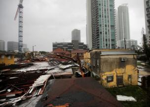 Roofs wey destroy for place wey people dey live for Miami, 10 September