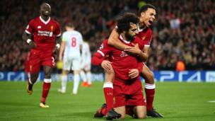 Mohamed Salah of Liverpool celebrates after scoring his side's seventh goal with Trent Alex Arnold of Liverpool during the UEFA Champions League group E match between Liverpool FC and Spartak Moscow at Anfield on December 6, 2017 in Liverpool, United Kingdom