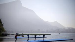 Athletes carry a scull towards training, Lagoa Stadium - Rio De Janeiro, Brazil