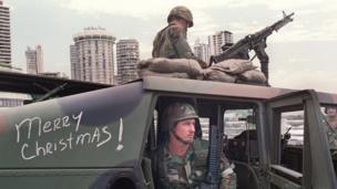 US soldiers man their security position outside the Vatican embassy in Panama City where Panamanian General Manuel Noriega is seeking asylum, during Operation Just Cause, on December 25, 1989