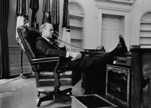 President Gerald R Ford takes a call at his desk in the Oval Office, 1974