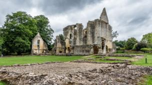 The picturesque ruins of Minster Lovell Hall beside the River Windrush