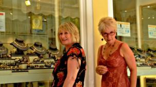 Women looking at jewellery in a shop window