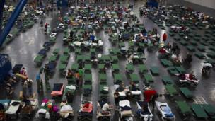 An emergency shelter with many beds in Houston.