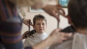 Peggy Whitson having her haircut