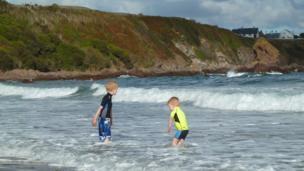 Boys paddle in Coldingham Bay