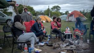 People around a campfire.